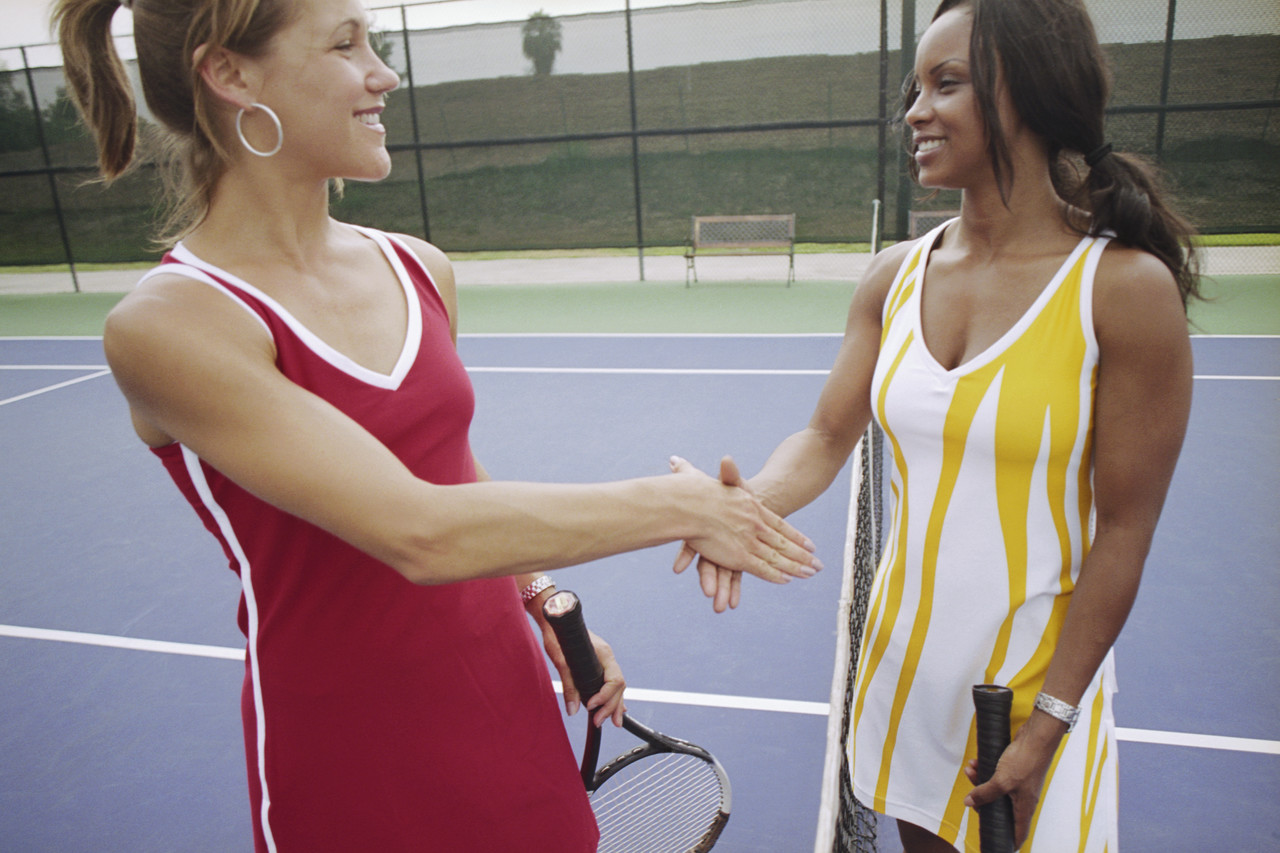 Female Tennis Players Shaking Hands