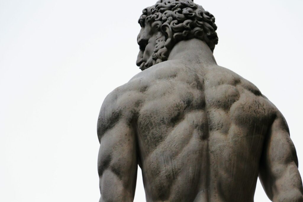 Backside of greek statue, a muscular man with Askēsis