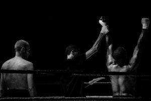 Boxer with arms raised