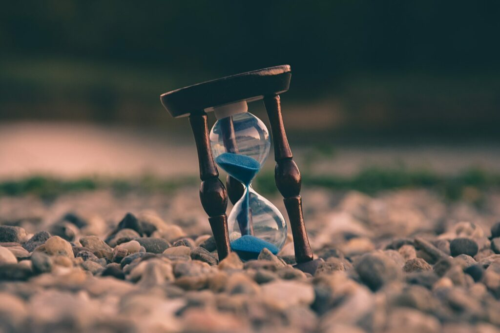 An hourglass, representing the mindset that doesn't waste precious time