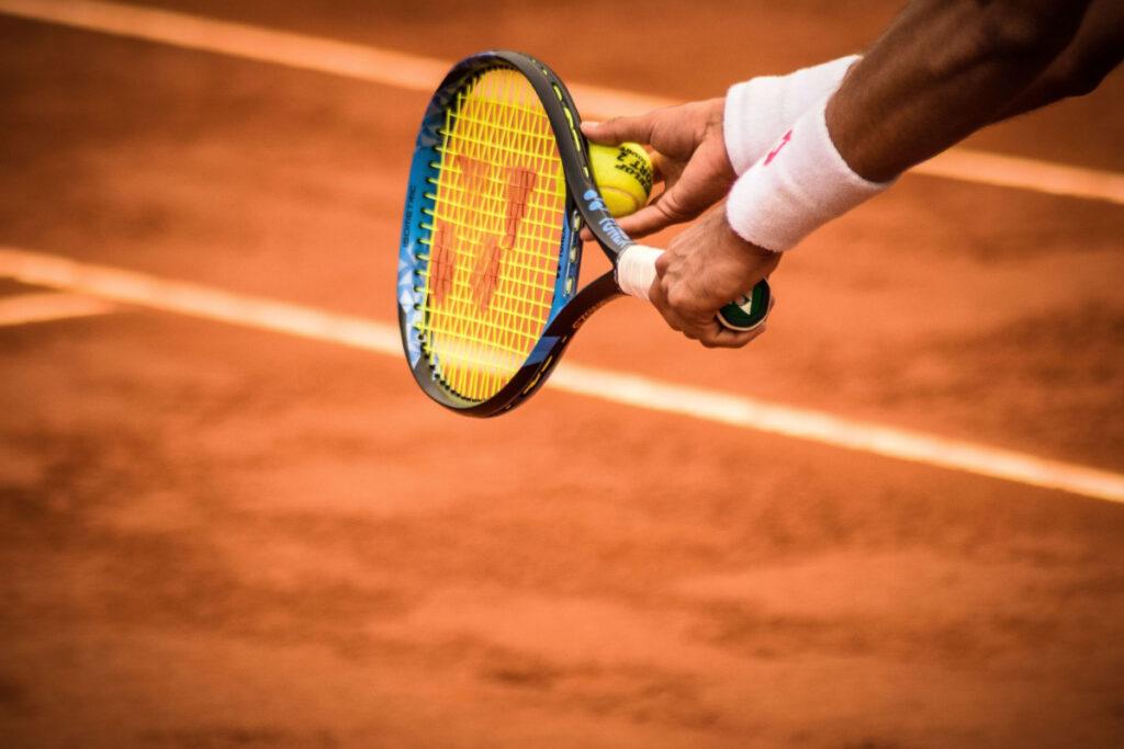 Man holding racquet