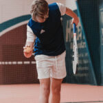 Young tennis player ready to serve