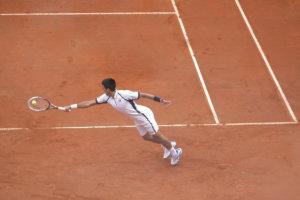Novak Djokovic returning a serve