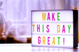 Sign that says make this day great